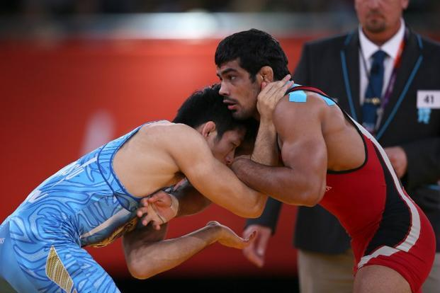 Wrestler Sushil Kumar (in red), the only Indian athlete who has won two Olympic medals in an individual sport, says the IOC's decision is a big blow for young and talented wrestlers. Photo: Marwan Naamani/AFP