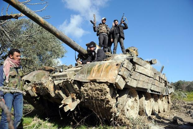 A file photo of rebel fighters in northern Syria. Photo: AFP