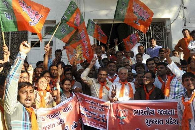 BJP workers celebrating their win in Ahmedabad. Photo: PTI