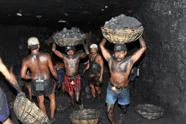 A file photo of coal miners carrying baskets of coal inside an underground mine at Godavarikhani, some 250 kilometers east of Hyderabad. Photo: AFP