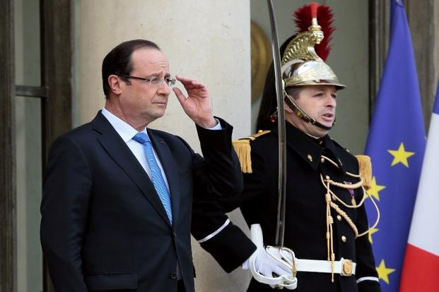 French President Francois Hollande last week raised the possibility of political interference in exchange rate policy when he called for a medium-term target for the euro's value, a move to counter its recent appreciation. Photo: AFP