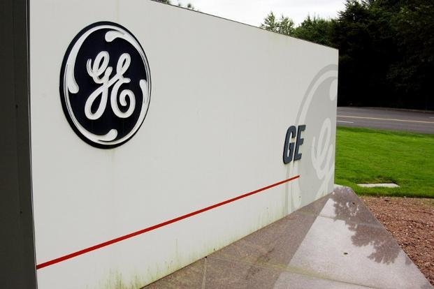 General Electric will use the money to accelerate its share repurchase programme to approximately $10 billion in 2013. Photo: AFP