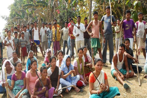 A file photo of protesters blocking a road in the Dhupdhara area of Goalpara district, some 135 km from Guwahati on Tuesday. Photo: AFP