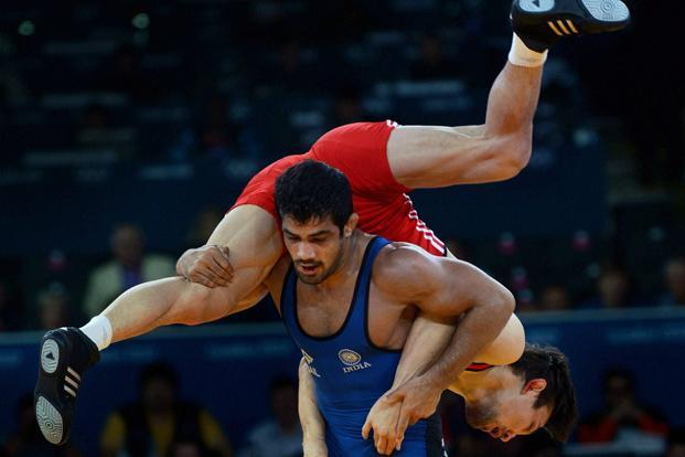 A file photo of Indian wrestler Sushil Kumar (in blue). Wrestling will remain on the programme for the 2016 Olympics in Rio de Janeiro but faces a fight against seven other sports for inclusion at the Games four years later. Photo: Manvender Vashist/PTI