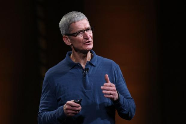 Apple CEO Tim Cook gave David Einhorn credit for a novel idea, but the usually unflappable chief executive turned slightly impatient when discussing the lawsuit. Photo: AFP