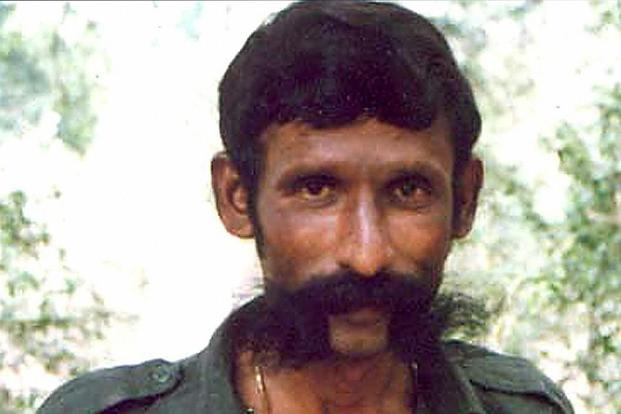 A file photo of sandalwood smuggler Veerapan. Mercy pleas of four of his associates was rejected by President Pranab Mukherjee on Wednesday. Photo: AFP