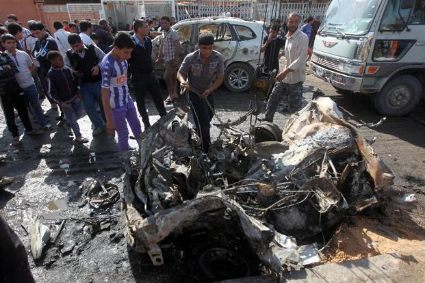 The site of a car bomb attack in Baghdad's impoverished district of Sadr City on Sunday. Photo: Ahmad Al-Rubaye/ AFP
