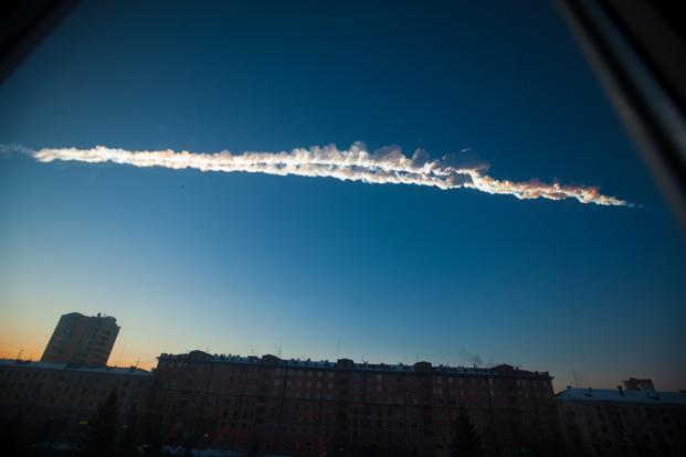 A meteorite contrail seen over Chelyabinsk. The space rock exploded a few dozen miles above Earth, but its pieces scattered over large areas of the industrial region. AP