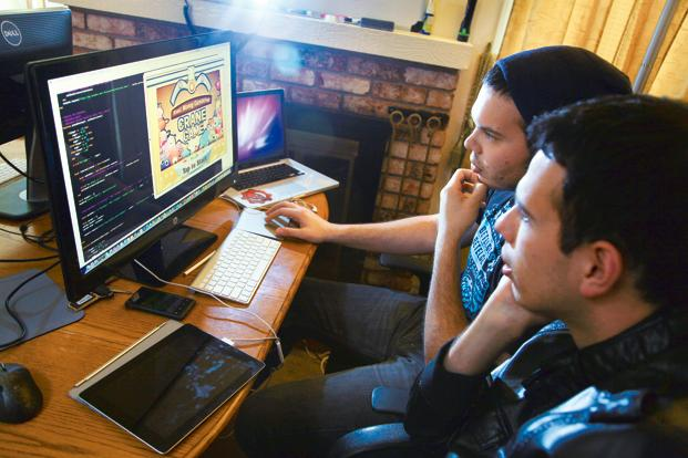 Cesar Miranda (left) and his brother Edgar, developers, work on their game Claw Crane at their home in California. With some states in the US poised to clear the way for legal gambling on the Internet, Silicon Valley's traditional gaming companies are expanding to meet the expected deluge of players. Photo: Jim Wilson/The New York Times (Jim Wilson/The New York Times)