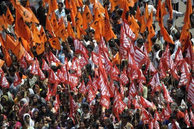 Workers participate in a rally in Hyderabad during the two-day strike called by trade unions to oppose the UPA government's economic policies. AFP
