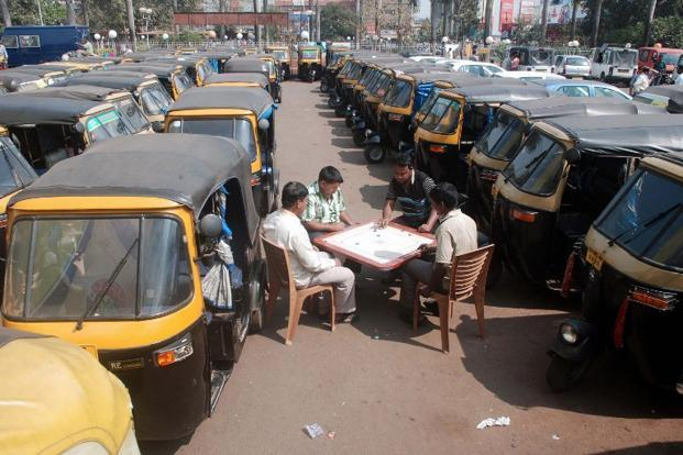 Auto-rickshaw drivers play carrom even as their vehicles stay stationery at an auto stand during the two-day strike in Bhubaneswar. AFP