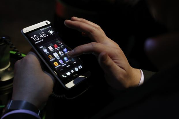 HTC has distinguished HTC One from rival Android devices by using new software—the BlinkFeed feature—to replace icons on the home screen with a personalized stream of news articles, social networking updates, photos and video. Photo: Reuters