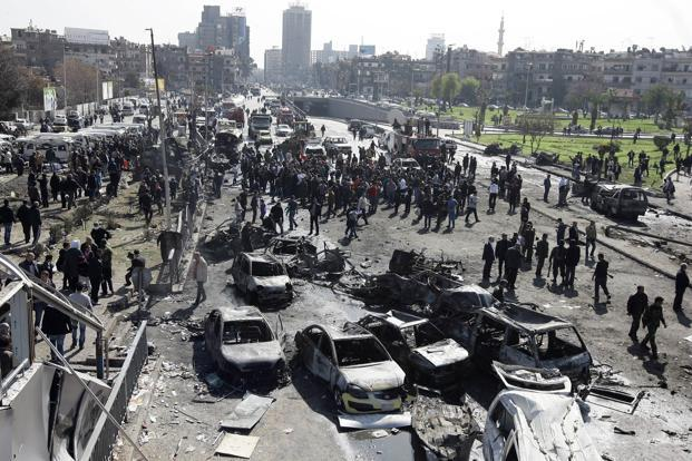 A general view shows burnt cars at the scene of a powerful car bomb explosion near the headquarters of Syria's ruling Baath party in the centre of Damascus on Thursday. Photo: AFP