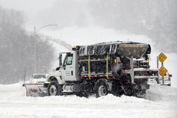A snowplow clears a road during a blizzard in Kansas City, Kansas. Photo:  Reuters