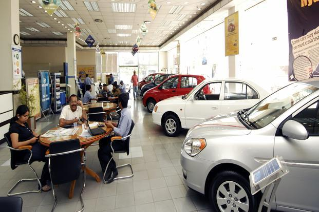 Customers sitting at a car showroom in New Delhi. Photo: Ramesh Pathania/Mint