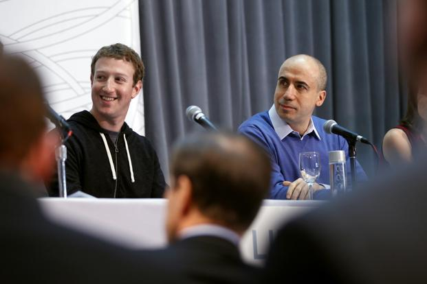 Facebook's Mark Zuckerberg, left, with venture capitalist Yuri Milner at the Life Sciences Breakthrough Prize announcement in San Francisco, California on Wednesday. Photo:  Robert Galbraith/Reuters