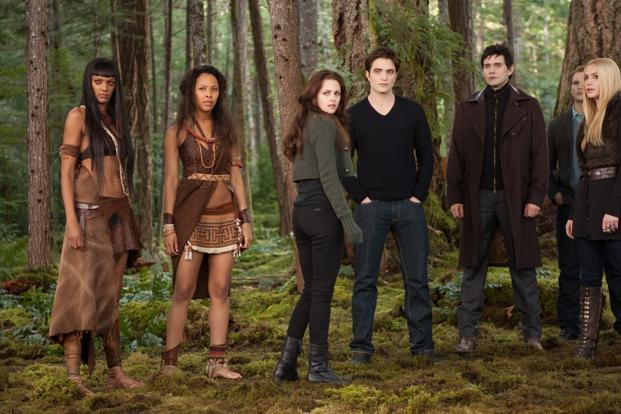 From left, Judith Shekoni, Tracey Heggins, Kristen Stewart, Robert Pattinson, Christian Camargo, Peter Facinelli and Casey LaBow in a scene from the film The Twilight Saga: Breaking Dawn Part 2. Photo: AP