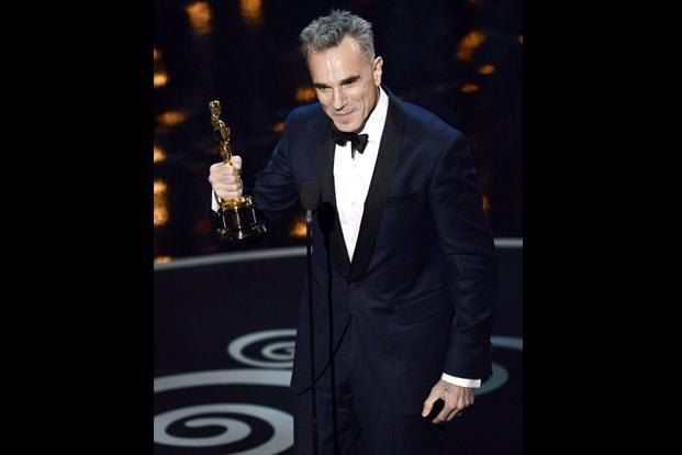 Actor Daniel Day-Lewis accepts the Best Actor award for <i>Lincoln. </i>His third Oscar in this category makes him the only actor ever to be thus honoured. AFP