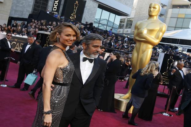 George Clooney and girlfriend Stacy Keibler at the 85th Academy Awards. Stacy Kiebler is in a Naeem Khan. Reuters
