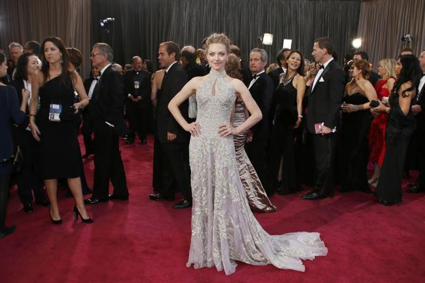 Guest Amanda Seyfried from <i>Les Miserables </i>wearing Alexander McQueen. Reuters