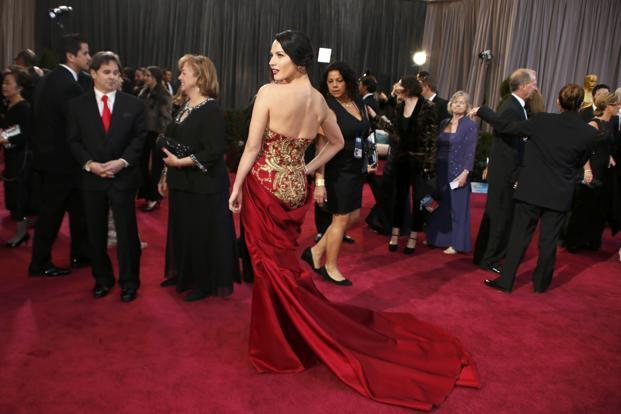 Olivia Munn shows off her red and gold Marchesa gown. Reuters
