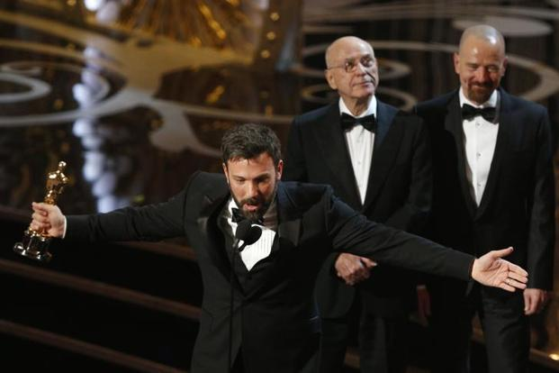 Director and producer Ben Affleck accepts the award for best motion picture for <i>Argo</i> as actors Alan Arkin (2nd left) and Bryan Cranston look on at the 85th Academy Awards. Reuters