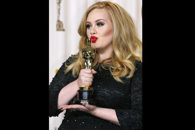 Adele Adkins poses with her Oscar for Best Original Song for <i>Skyfall. </i>The singer gave another flawless performance on stage confirming her reputation as one of the finest voices of our time. Reuters