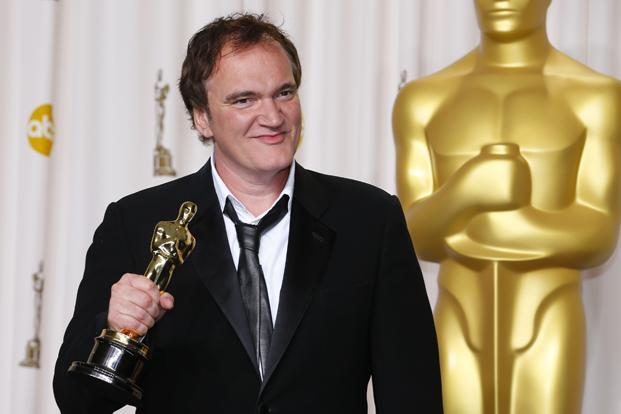 Director Quentin Tarantino poses with his Oscar for best original screenplay for <i>Django Unchained</i>. Reuters