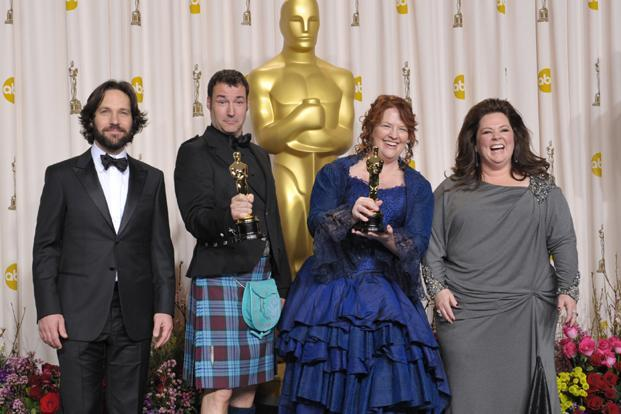 From left: Presenter Paul Rudd, director Mark Andrews, Brenda Chapman, and Melissa McCarthy pose with their award for best animated feature film for 'Brave' at the Oscars in Los Angeles. Photo: John Shearer/ AP