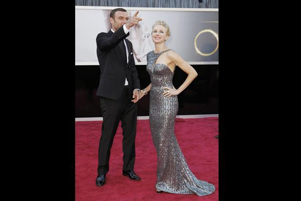 Naomi Watts, best actress nominee for her role in <i>The Impossible</i>, with her partner Liev Schreiber and an Armani Prive dress, Jimmy Choo shoes and Neil Lane jewels. Reuters