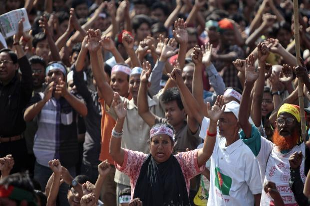 Bangladeshi activists shout slogans demanding the execution of Jamaat leader Sayedee and others convicted of war crimes in Dhaka on Thursday. Photo: AP  (AP )