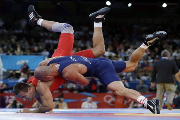A file photo Amer Hrustanovic of Austria competes against Damian Janikowski of Poland, (in blue) , during the 84kg Greco-Roman wrestling competition at the 2012 Summer Olympics, in London. Photo: AP