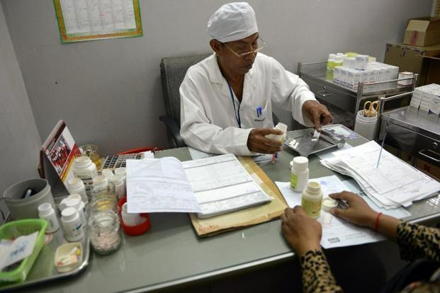 A file photo of a doctor administering medicines to an HIV positive patient. Photo: Tang Chhin Sothy/AFP