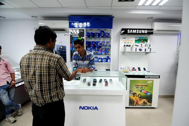 Smartphone prices have fallen globally and the rollout of data-centric 4G wireless networks have made these 'do-it-all' devices increasingly attractive for users. Photo: Pradeep Gaur/Mint (Pradeep Gaur/Mint)