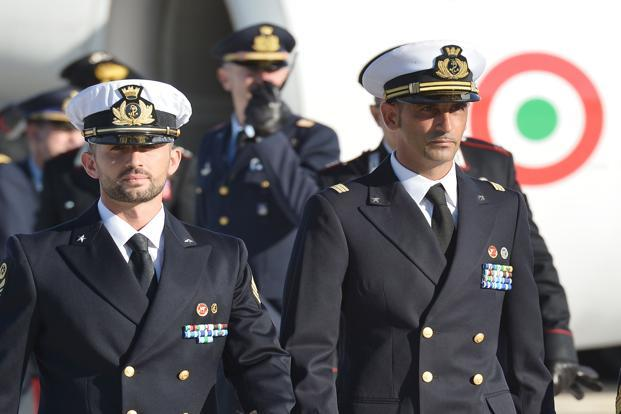A file photo of Italian marines Massimiliano Latorre (right) and Salvatore Girone arriving at Ciampino airport near Rome in December 2012. Photo: Vincenzo Pinto/AFP