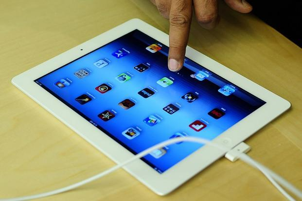 iPad shipments are expected to account for 46% of the market in 2013, down from 51% last year. Photo AFP
