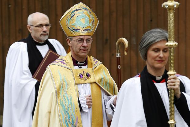Justin Welby arrives for his enthronement ceremony, in Canterbury. He faces a tough balancing act to keep the 80 million-strong Anglican Communion together. Photo: Luke MacGregor/Reuters