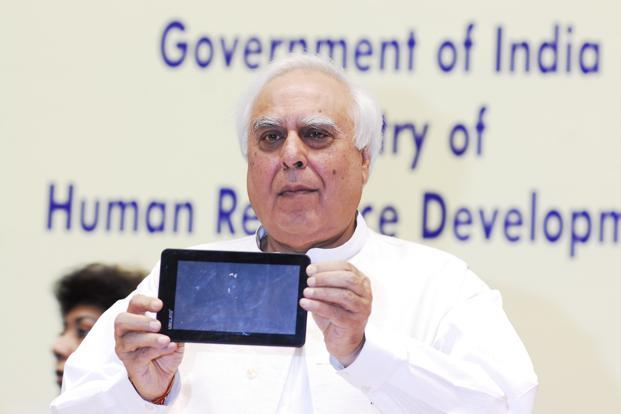 An October 2011 photo of Union minister for communications and information technology Kapil Sibal during the launch of the Aakash tablet in New Delhi. Photo: Mint (Mint)