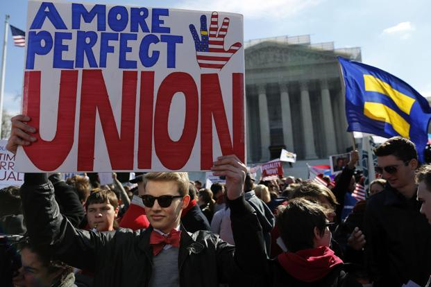Protesters against the Defense of Marriage Act (DOMA) in front of the US Supreme Court. On the second day of the arguments, a majority of the court raised serious concerns with the DOMA, enacted in 1996 under President Bill Clinton. Reuters