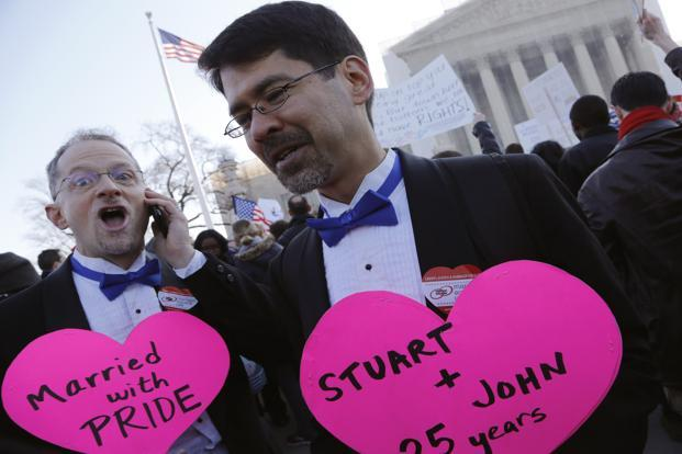 A gay couple outside the US Supreme Court. US President Barack Obama, along with many members of Congress - Democrats and Republicans as well as former President Bill Clinton, have endorsed gay marriage. Reuters
