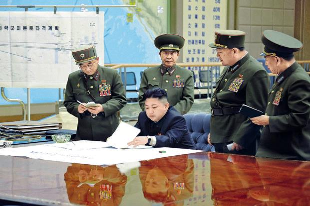 North Korean leader Kim Jong-Un discussing the strike plan with officers at a meeting in an undisclosed location on Friday. Photo: AFP/KCNA via KNS