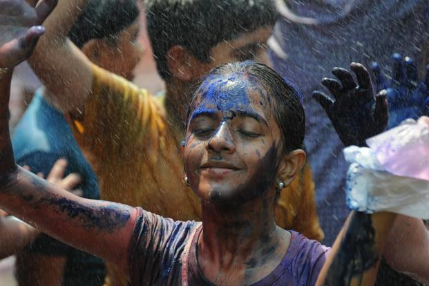 Every year during Holi, the sight of full-grown men and women lustily smearing one another with gulal makes me think of 'action painting'. Photo: HT