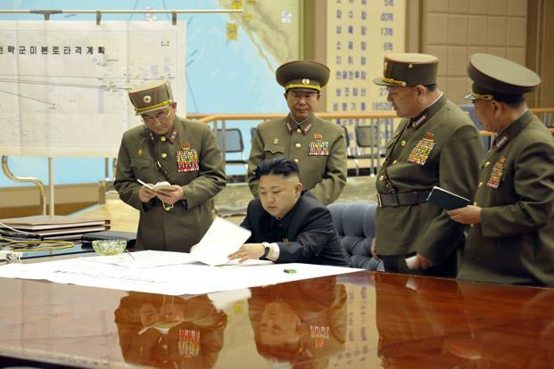 North Korean leader Kim Jong-Un (center) presides over an urgent operation meeting on the Korean People's Army Strategic Rocket Force's performance of duty for firepower strike at the Supreme Command in Pyongyang. Photo: Reuters