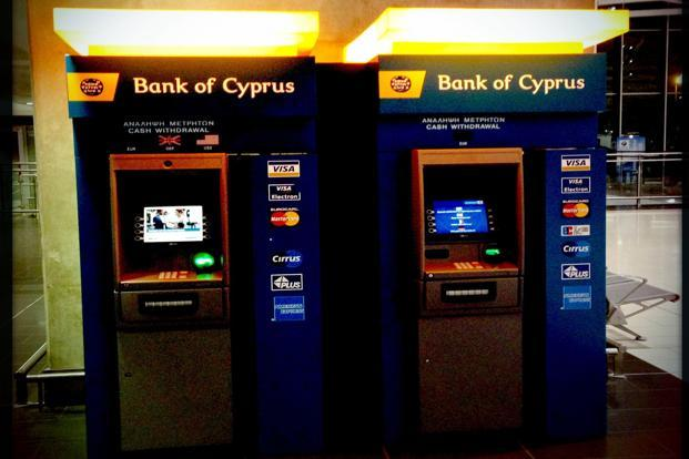 About 22.5% of deposits over €100,000 will attract no interest, Bank of Cyprus said in a decree. Photo: AFP