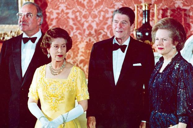 In a 10 June 1984 photo, Britain's Queen Elizabeth II (second from left) stands with West Germany's Chancellor Helmut Kohl (left), US President Ronald Reagan (second from right), and Thatcher at Buckingham Palace. Photo:AP