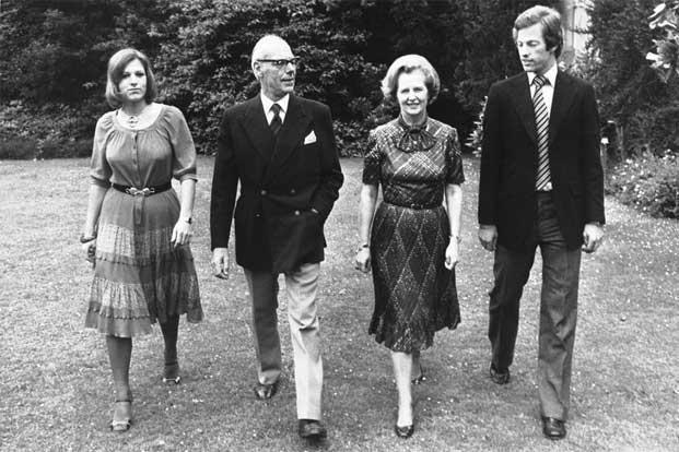Thatcher takes a stroll through the grounds of Scotney Castle in Kent, with her husband Denis and their twins Mark (extreme right) and Carol (extreme left). The twins were born on 15 August 1953. Photo:AP