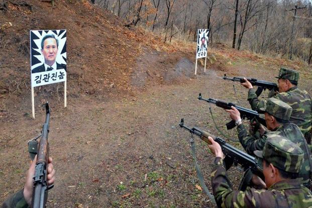 North Korean soldiers take part in shooting training with images of South Korean defense minister Kim Kwan-Jin. A news reports on 8 April said South Korea suspects that North could be preparing for another nuclear test. AFP/KCNA