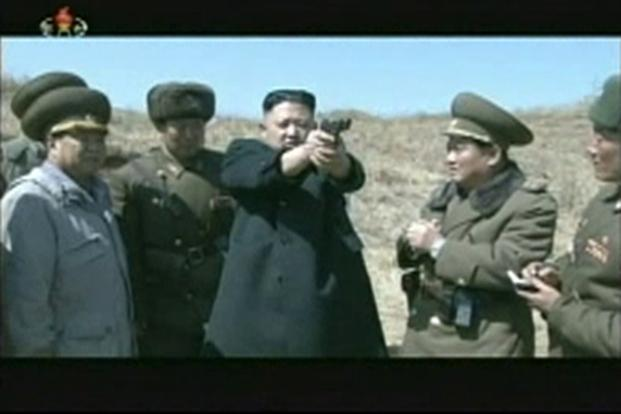 "North Korea's leader Kim Jong-un holds up a pistol as he supervises firing drills on 5 April. Following the US-South Korea annual military drills, on 30 March, North said it is entering a ""state of war"" with South. Reuters/KCNA"