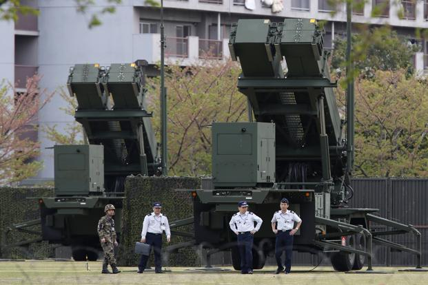 Japan self-defence forces soldiers walk near Patriot Advanced Capability-3 (PAC-3) missiles at the defence ministry in Tokyo on Tuesday. Photo: Reuters