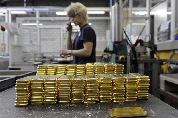 Employees prepare gold ingots for shipping at the Argor-Heraeus SA gold producing and refining plant in Mendrisio, Switzerland. Photo: Bloomberg